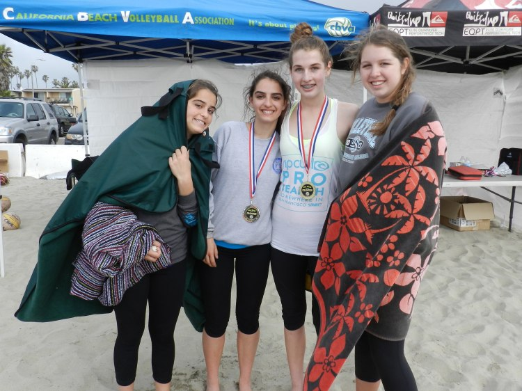(l-r) Sisters Gabby Belizzi, Phia Belizz, Emma Calle and Rachel Ahrens. Gold Medalists Emma and Phia center; Bronze Gabby and Rachel donning the day's most desired beach attire :)